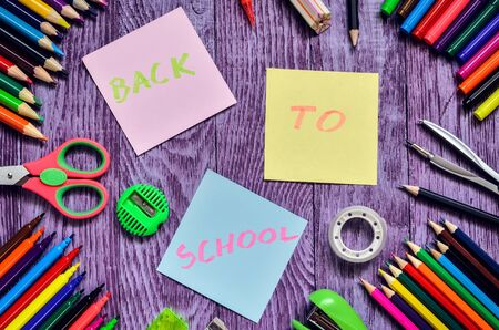 Creative idea depicting the return of children to school. School supplies with the text back to school.
