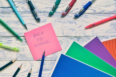 Creative concept with school supplies. Frame with school accessories on a wooden background. Stock fotó