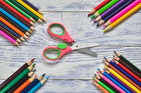 Concept with school accessories. Colorful school supplies on the wooden table.