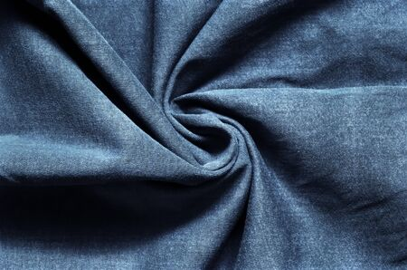 Interesting conceptual background with clothes. Texture from navy blue wrinkled material.