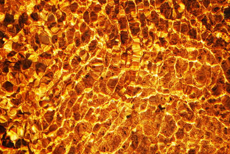 wavelet: gold color water in the stream. liquid gold background Stock Photo