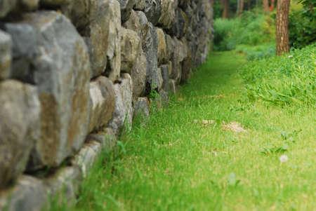 Korea stone wall on the grass Stock Photo