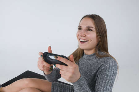 Cheeful involved girl playing video games