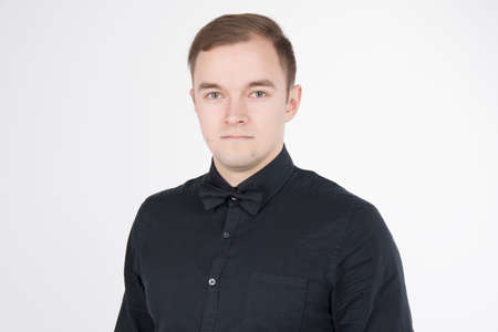 Young man wearing black shirt with bow isolated