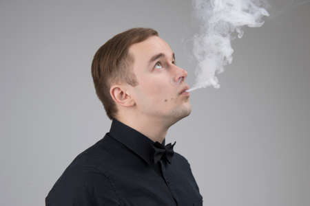 Young man vaping with mod isolated