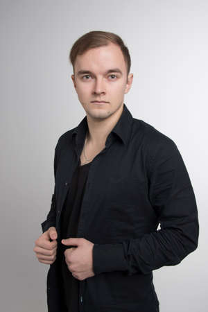 Young man wearing black shirt isolated