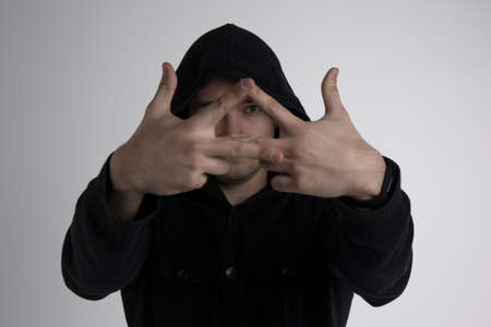 Young man showint triangle with fingers isolated
