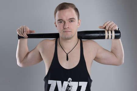 Young man holding baseball bat isolated