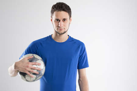 Soccer player blue shirt with ball isolated