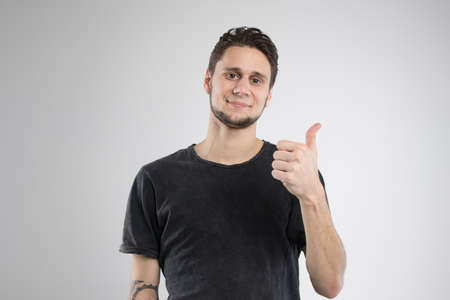 Young man happy in black shirt isolated Фото со стока