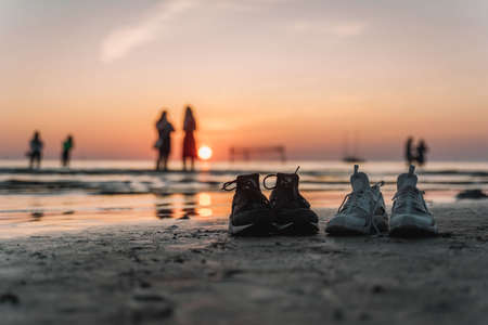 Sneakers on sea background. Relax concept. Active lifestyle.