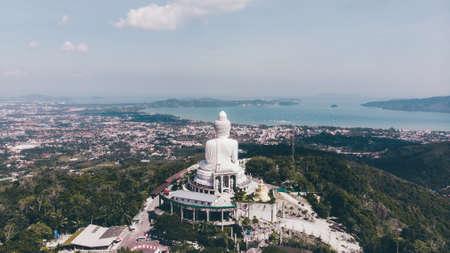 Big buddha aerial thailand jungle on sky background. Фото со стока