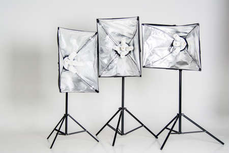 Studio lighting isolated on white background with black stands