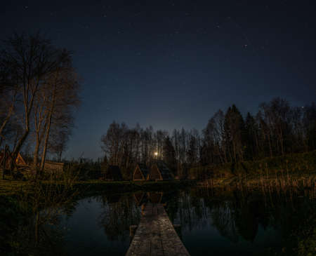Night landscape water wooden, great design for any purposes. Night sky nature summer landscape. Summer vacation.