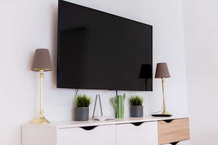 black tv on the apartment wall