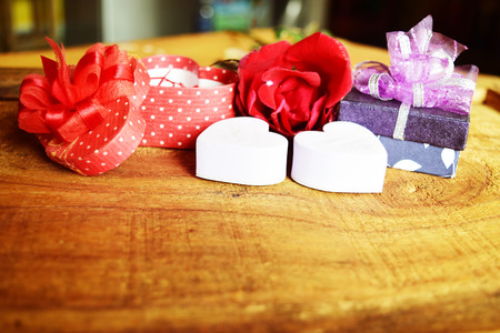 heart shaped stuff: Sweet holiday background with rose and gifts