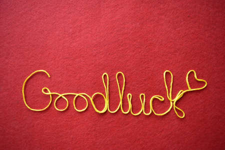 goodluck: goodluck ribbon greeting and hearts on red background