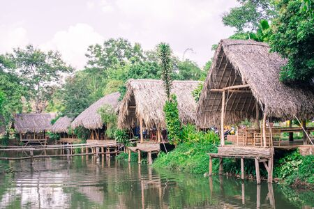 dispersed: old huts and piles of straw and wood where they dwelled fishermen Stock Photo