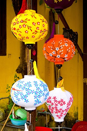 hoi an: Lanterns hanging from sticks of khc colors in Hoi An Stock Photo