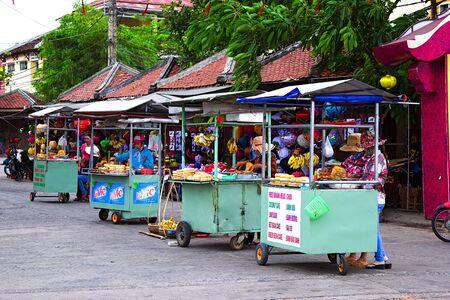 vendor: local Vietnamese women street vendor in Hoi An Editorial