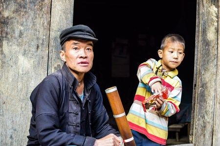 feed the poor: HA GIANG, VIETNAM - November 08,2015: Hmong man. Dong van, Vietnam.
