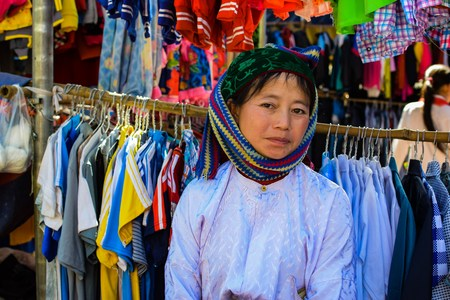 silver jewellery: Ha Giang, Viet Nam - November 08, 2015:Unidentified traditionally dressed girls of Hmong ethnic minority tribe in Vietnam. Hmong people are known for their indigo-dyed costumes and ornate silver jewellery