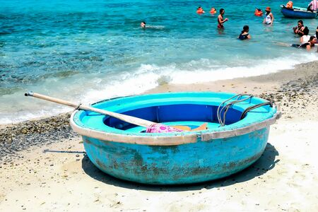 con dao: Traditional Vietnamese boats on the beach.