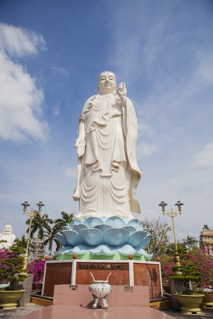 maitreya: Maitreya Buddha statue located in the famous Vinh Trang pagoda in My Tho city, Tien Giang province, Vietnam. Stock Photo