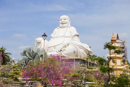 Maitreya Buddha statue located in the famous Vinh Trang pagoda in My Tho city, Tien Giang province, Vietnam. 版權商用圖片