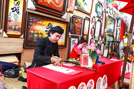 indian paint brush: Vietnamese lunar year festival scholar. This is a tradition of the Vietnamese lunar new year Editorial