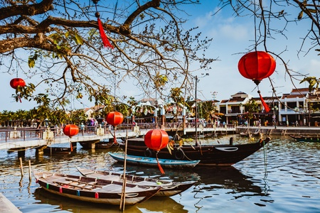HOI AN, VIETNAM - MARCH 15, 2017: Bridge with decorating lamps and boat over Hoai river in Hoi An ancient town Quang Nam Vietnam. Editorial