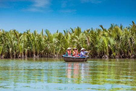 HOI AN, VIETNAM - MARCH 19, 2017: Tourists visit water coconut forest in Hoi An Editorial