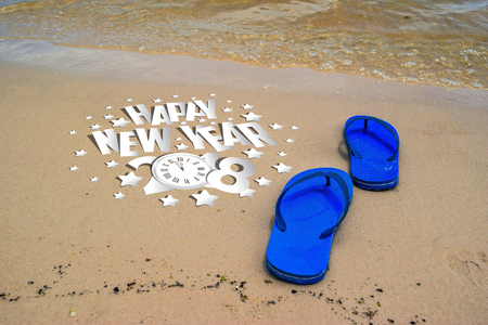 flip flops: New Year 2018 is coming concept with flipflops on a beach sand