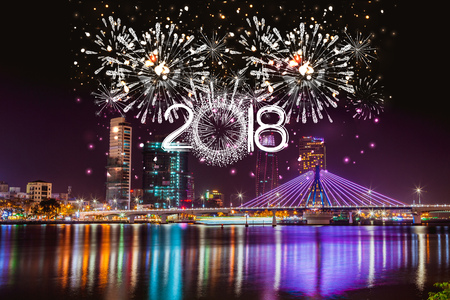 Cheerful fireworks display in city night and bridge