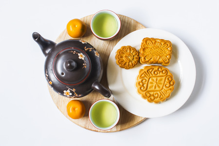 Moon cake and tea for Chinese mid autumn festival. Isolated on white. Copy space 스톡 콘텐츠