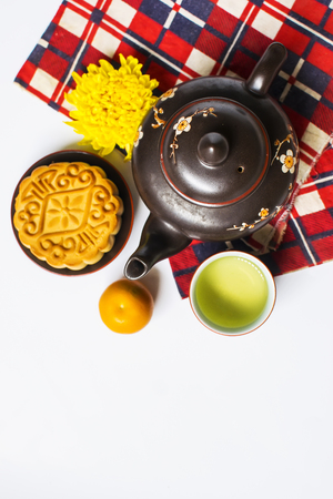 Moon cake and tea for Chinese mid autumn festival. Isolated on white. Copy space Stock Photo