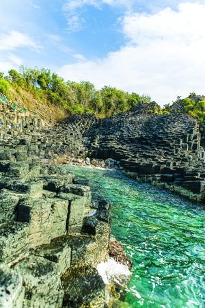 Ganh Da Dia, Phu Yen, Viet Nam, masterpiece of nature, wonderful, fantastic heritage, abstract place for Vietnam travel, rock make great terrain, boat on sea make beauty landscape of ganhdadia