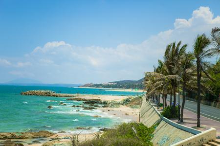 Beautiful beach with blue sky and coconut in Mui Ne, Binh Thuan province, Vietnam