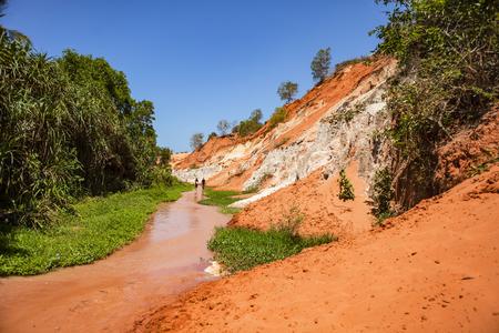 Fairy Stream Canyon Red river between rocks and jungle Mui Ne Vietnam Stock Photo