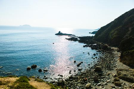 Rocks in the blue sea of Eo Gio cape, Binh Dinh province, Vietnam.