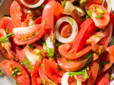 Salad from tomatoes with onions and greens with vegetable oil photo