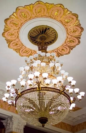 pilasters: The Big chandelier in the high hall Stock Photo