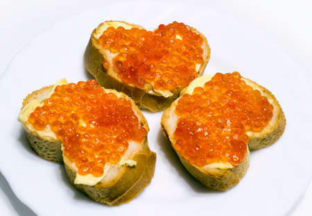 repast: Sandwiches: red caviar, yellow butter, white loaf