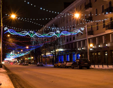 The city decorated with light garlands by New year photo