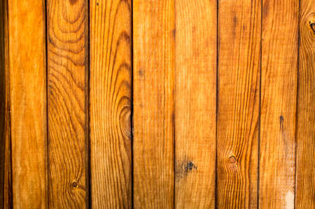 Natural wooden lining, with a vertical surface