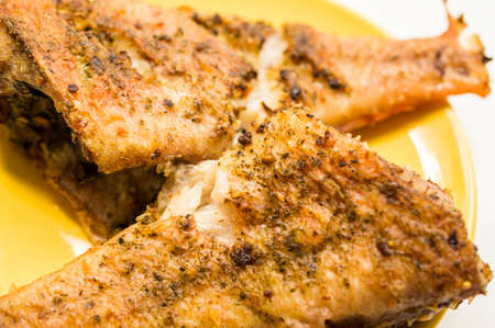 breading: The grouper, fried on a frying pan without breading
