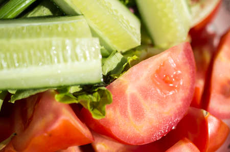 repast: Cucumber, reasonable tomatoes and fresh lettuce leaves Stock Photo