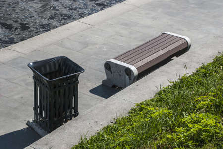 litterbin: Bench on the embankment in the summer afternoon