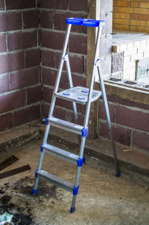 stepladder: The construction step-ladder in the room under construction Stock Photo