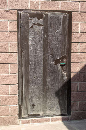 polyethylene film: The door in a brick wall of the house Stock Photo